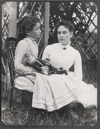 Hellen Keller holding doll with Anne Sullivan 1888
